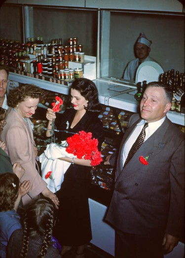 Stanley Genetti with Miss America at store opening